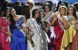 Miss Universe 2013 Gabriela Isler, from Venezuela, center, waves after winning the 2013 Miss Universe pageant in Moscow, Russia, on Saturday, Nov. 9, 2013.