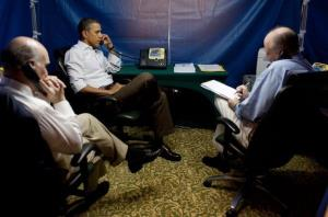 President Obama takes a call inside his security tent during a 2011 trip to Brazil.