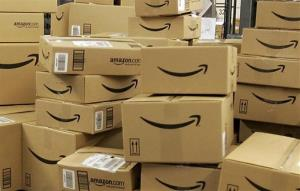 This Dec. 13, 2005 file photo shows stacks of Amazon.com boxes with merchandise for shipment, at the Amazon.com fulfillment center in Fernley, Nevada.