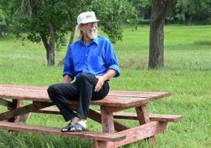 Craig Cobb sits on a picnic bench in Leith, ND, where he has purchased about a dozen lots and invited fellow white supremacists to move there.