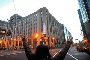 A man chants and stretches outside Twitter's headquarters  in San Francisco.