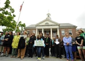People gather to mark the six-month anniversary of the shooting in Newtown, Conn., Friday, June 14, 2013.