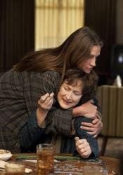 This publicity image released by The Weinstein Company shows, from left, Julia Roberts and Meryl Streep in a scene from August: Osage County.