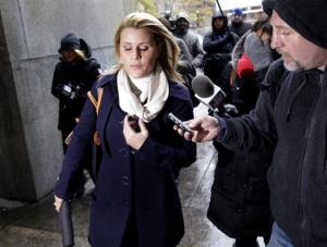 Genevieve Sabourin, who is charged with stalking actor Alec Baldwin, speaks with reporters as she arrives for her trial at criminal court Tuesday, Nov. 12, 2013, in New York.