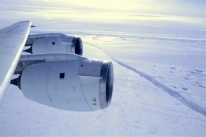 NASA's DC-8 research plane flies across the crack forming across the Pine Island Glacier ice shelf in Antarctica, which ended up creating a new iceberg.
