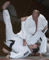 In this Friday, Dec. 18, 2009 file photo, Russian Prime Minister Vladimir Putin, right, is seen during judo training at a sports school in St. Petersburg, Russia.