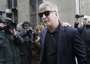 Alec Baldwin leaves criminal court in New York, Tuesday, Nov. 12, 2013.