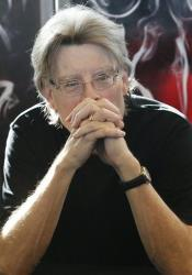Stephen King poses for the cameras prior to an autograph session during a promotional tour in France for his last book Doctor Sleep at a library in Paris, Wednesday Nov. 13, 2013.