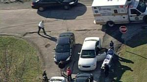 In this aerial image provided by KDKA-TV, emergency personnel head to the scene near Brashear High School in Pittsburgh.