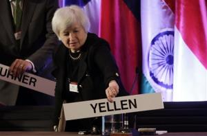 FILE - In this  Monday, June 3, 2013, file photo, Janet Yellen, vice chair of the Board of Governors of the Federal Reserve System, places her name plate at her seat at the International Monetary Conference in Shanghai, China. Janet Yellen is expected to face skepticism at a hearing Wednesday,...