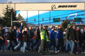 Boeing machinists march to cast their vote at the International Association of Machinists union hall in Everett, Washington.