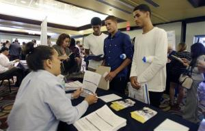This Wednesday, Aug. 14, 2013 photo shows a job fair in Miami Lakes, Fla.