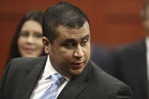 In this Monday, July 1, 2013 photo, George Zimmerman enters the Seminole County Courthouse in Sanford, Fla.