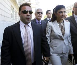 "In this July 30, 2013 photo, ""The Real Housewives of New Jersey"" stars Joe Giudice, left, and his wife, Teresa Giudice, walk out of Martin Luther King Jr. Courthouse after an appearance in Newark, NJ."