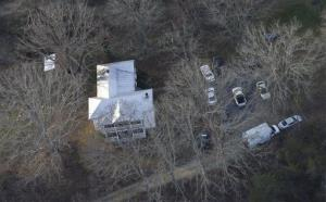 Virginia State police investigators surround the home of Virginia State Sen. Creigh Deeds in Millboro, Va., Tuesday, Nov. 19, 2013.