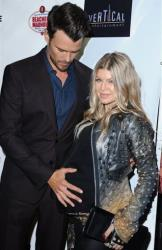 Josh Duhamel, and his wife, Fergie, arrive on the red carpet for the premiere of Scenic Route at the Chinese 6 Theater on Tuesday, Aug. 20, 2013 in Los Angeles.