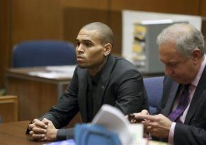 Chris Brown, left, is shown with his attorney Mark Geragos during a hearing in Los Angeles yesterday.