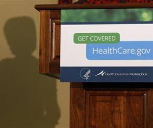 In this Friday, Nov. 15, 2013 photo, the shadow of Health and Human Services Secretary Kathleen Sebelius is shown as she speaks at the Community Health and Social Services Center in Detroit.