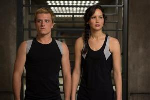This image released by Lionsgate shows Josh Hutcherson as Peeta Mellark, left, and Jennifer Lawrence as Katniss Everdeen in a scene from The Hunger Games: Catching Fire.