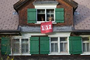 A banner is fixed at the window of a house in  Wildhaus, Switzerland, to support the referendum.
