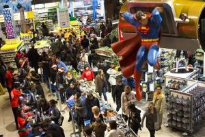 Shoppers wait on a check-out line in the Times Square Toys-R-Us store after doors were opened to the public at 8pm on Thanksgiving, Thursday, Nov. 22, 2012, in New York.