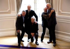 From left, Michael Palin, Eric Idle, Terry Jones, Terry Gilliam, and John Cleese pose for photographers to promote the reunion.