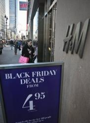 An H&M store advertises Black Friday Deals on Saturday, Nov. 23, 2013, in New York.