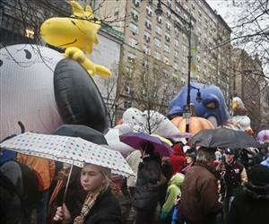 Scores braved the rains to see the inflation of the balloons for the Macy's Parade on Wednesday, Nov. 27, 2013 in New York.