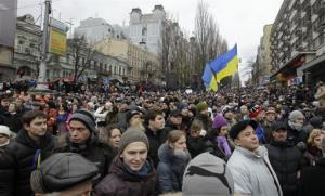 Ukrainian protesters crowd a boulevard as they march to Independence square in downtown Kiev, Ukraine, on Sunday, Dec. 1, 2013.