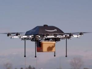 A Prime Air drone with an Amazon delivery bucket.