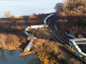 Cars from a Metro-North passenger train are scattered after yesterday's derailment.