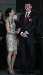 James Packer, right, and his wife Erica Baxter attend the opening ceremony for hard Rock Hotel at the City of Dreams, one of the giant casino complex in Macau, Monday, June 1, 2009.