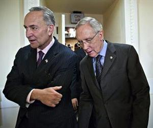 In this Nov. 21, 2013, photo Sen. Charles Schumer and Harry Reid, depart a news conference on Capitol Hill.