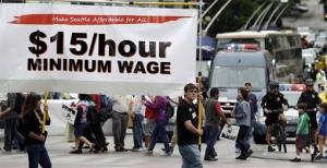 In this Aug. 1, 2013 photo, demonstrators protesting what they say are low wages and improper treatment for fast-food workers march in downtown Seattle.