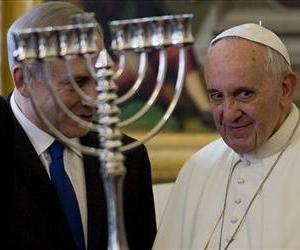 Israeli Prime Minister Benjamin Netanyahu, left, presents Pope Francis with a Menorah during their meeting at the Vatican, Monday, Dec. 2, 2013.
