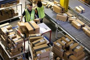 Amazon.com employees organize outbound packages at an Amazon.com Fulfillment Center on Cyber Monday.