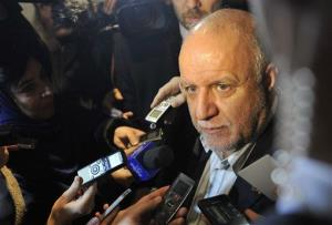 Iran's Minister of Petroleum Bijan Namdar Zangeneh talks ro journalists as he arrives at a hotel in Vienna, Austria, on Tuesday, Dec. 3, 2013.