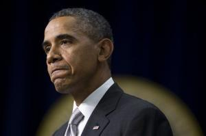 President Barack Obama pauses as he speaks about the new health care law Tuesday, Dec. 3, 2013.
