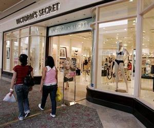 Shoppers walk past a Victoria Secret store in San Jose, Calif.