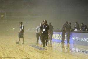 Smoke engulfs the court at the Mexico City last night.