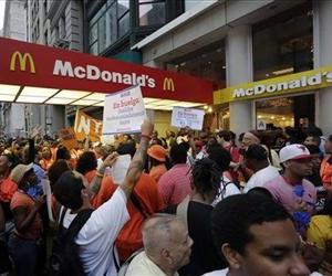 Protesting fast food workers demonstrate outside a McDonald's restaurant on New York's Fifth Avenue, in New York, Aug. 29, 2013.