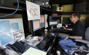 David Anselmi, a Microsoft senior manger of investigations in the company's Digital Crimes Unit, sits in the DCU lab there Wednesday, Sept. 12, 2012, in Redmond, Wash.