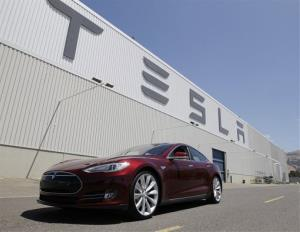 This June 22, 2012 file photo shows a Tesla Model S outside the Tesla factory in Fremont, Calif.