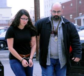Miranda Barbour is led into District Judge Ben Apfelbaum's office in Sunbury, Pa., by Sunbury policeman Travis Bremigen.