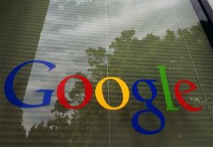 This April 12, 2012, photo shows a Google logo on a window at the company's headquarters in Mountain View, Calif.
