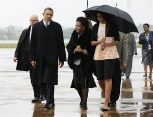 President  Obama and first lady Michelle Obama arrive at Waterkloof Air Base this morning.