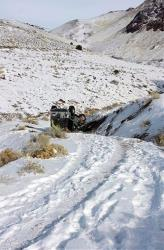 This Tuesday, Dec. 10, 2013 photo provided by searcher Lucia Gonzalez shows the vehicle belonging to a family who went missing after a trip to play in the snow near Lovelock, Nev.