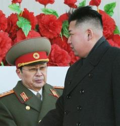 In this Feb. 16, 2012, photo, North Korean leader Kim Jong Un walks past his uncle Jang Song Thaek, left, after reviewing a parade.