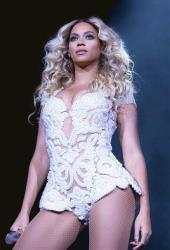 Beyonce performs onstage at her  Mrs. Carter Show World Tour 2013, on Monday, Dec. 9, 2013 at the American Airlines Center in Dallas, Texas.