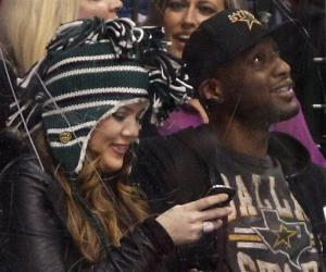 Khloe Kardashian, left, and her husband Lamar Odom, right, sit rinkside as they take in an NHL hockey game between the Chicago Blackhawks and Dallas Stars, Friday, March 16, 2012, in Dallas.